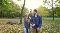Young couple dating in park - stock footage