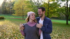 Young couple dating in park Stock Footage
