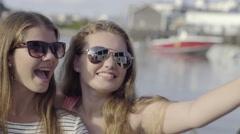 Closeup Of Girls Posing For Selfies At A Marina Stock Footage