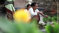 Balinese woman preparing the offerings for ceremony Stock Footage