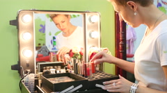 Woman master stylist review her make-up cosmetic tools Stock Footage