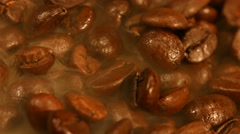 Coffee beans are steaming close up Stock Footage