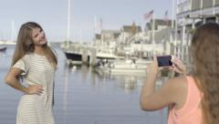 Teen Takes Photos Of Her Friend Posing In Front Of Marina Stock Footage