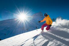 Girl telemark skiing snow slope in mountains - stock photo