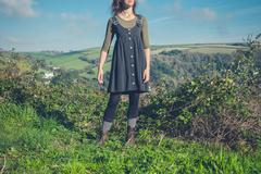 Young woman standing on a hilltop Stock Photos