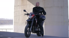 Biker lifestyle. Motorcycle driver and his bike Stock Footage