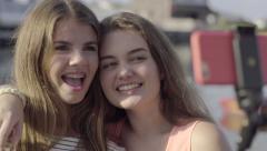 Teenage Girls Have Fun Using Selfie Stick To Take Summer Vacation Photos - stock footage