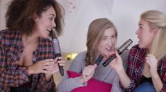 4K Teenage girls having fun, singing into hairbrushes in bedroom Stock Footage