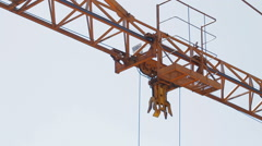 Extreme close-up of tower crane hoisting mechanism - stock footage
