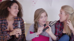 4K Teenage girls having fun, singing into hairbrushes in bedroom - stock footage