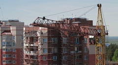 High building crane front new house Stock Footage