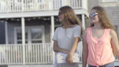 Teenage Girls Walk Home With Pizza Take-Out Boxes Stock Footage