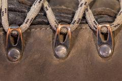 Detail of trekking shoes hook and loop for the strap. - stock photo
