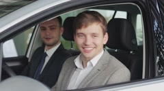 Happy customer holding the keys to his new car Stock Footage