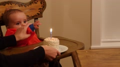 Baby boy eating his birthday cake with his family Stock Footage