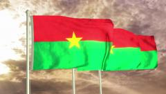 Three flags of Burkina Faso waving in the wind (4K) Stock Footage