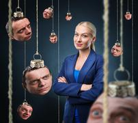 Woman with man's head hanging Stock Photos