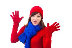 Happy winter girl in red hat, mittens, ckarf over white background - stock photo