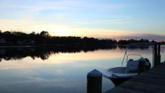 Docked Boat on the Indian River at Sunset - Pan Down - stock footage
