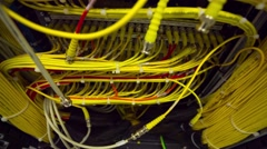 Back Side Of Modern Working Data Center Servers With Yellow Cable - Tilt Up Stock Footage
