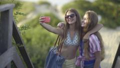Cute Teen Girls Take Fun Selfies Together At Beach - stock footage
