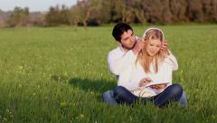 Young couple with digital tablet an head phones Stock Footage