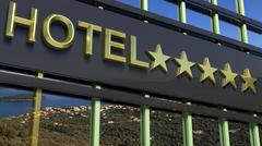 Metallic hotel sign board with five golden stars and island with seascape as  Stock Illustration