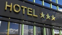 Metallic glass hotel sign board with three golden stars, text and skyscrapers - stock illustration