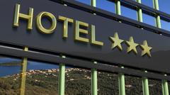 Metallic hotel sign board with three golden stars and island with seascape as - stock illustration