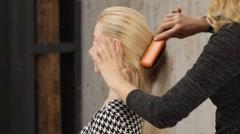 Beautiful blonde hair make styling. Stock Footage