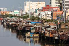 Slum and modern buildings in Saigon Stock Photos