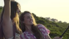 Girlfriends Pose For Fun Beach Vacation Selfies With Gopro Stick Stock Footage