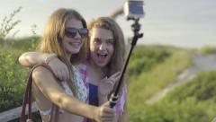 Teen Girls Use Gorpro Stick To Take Fun Selfies At Beach Stock Footage