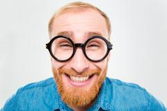 Funny cheerful bearded man in round glasses Stock Photos