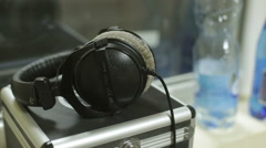 Headphones resting on the dj case Stock Footage