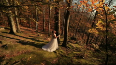 Beautiful wedding couple hugging against the backdrop of the fairy forest Stock Footage