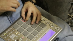 Beatmaker Works on the MPC Stock Footage