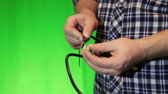 Electritian mounting the wires - stock footage