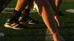 Close up of a football player running from the line of scrimmage Stock Footage