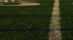 Close up of a football player lining up at the line of scrimmage - stock footage