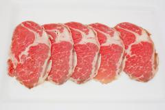 Stock Photo of High grade sliced Hida wagyu beef isolated on white background
