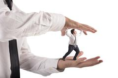 Oppressed by boss - stock photo