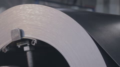 Metal coil rotate on the machine close up Stock Footage