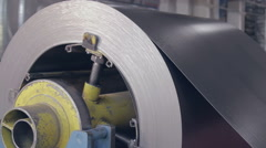 metal coil rotate on the machine - stock footage
