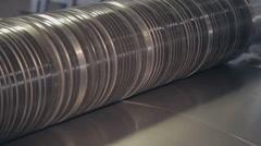 Metal sheet passes through the machine 2 Stock Footage