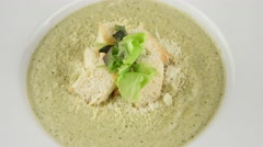 Broccoli cream soup with roasted rusks Stock Footage