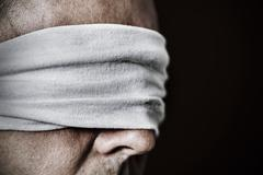 Young man with a blindfold in his eyes Stock Photos
