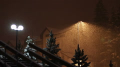 Snowing at night on the background of a lamppost - stock footage