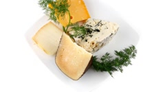 Aged cheeses on white porcelain plate Stock Footage