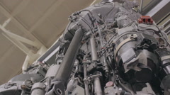 Pan to jet engine repair Stock Footage